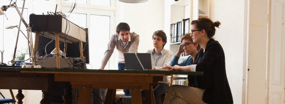 four young people working together